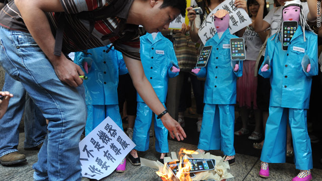 On may 25, students in Hong Kong burn Apple products in effigy to protest conditions at Chinese factories that make them.